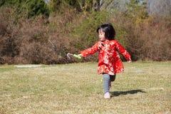 Happy bubble run Chinese girl