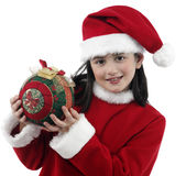 Pretty little girl with Christmas clothes Royalty Free Stock Photography