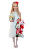 Pretty little girl with Christmas presents Stock Photography