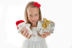 Pretty little girl with Christmas presents Stock Images