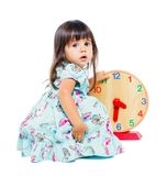 Pretty little girl with clock Stock Photos