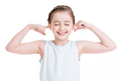 Pretty little girl closed ears. Pretty little girl closed ears - isolated on white Royalty Free Stock Photography