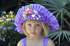 Pretty little girl in colorful hat Stock Photos