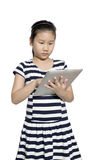 Pretty little girl with a computer tablet Royalty Free Stock Photography