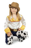 Pretty little girl in cowboy costume on the white background.  Stock Photography