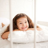 Pretty little girl in the crown waking up Stock Images