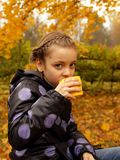 Pretty little girl with a cup in hand Stock Photography