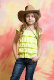 Pretty little girl with cute face in western cowboy hat Royalty Free Stock Photos