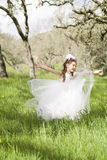 Pretty Little Girl Dancing In Field Royalty Free Stock Photos
