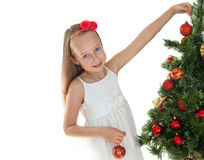 Pretty little girl decorating Christmas tree Royalty Free Stock Image