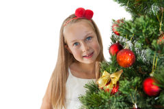 Pretty little girl decorating Christmas tree Royalty Free Stock Photos
