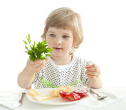 Pretty little girl demonstrating fresh parsley Royalty Free Stock Image