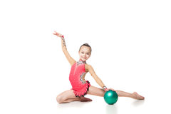 Pretty little girl doing gymnastics with a ball Stock Image