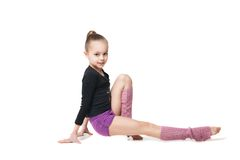 Pretty little girl doing gymnastics over white Royalty Free Stock Photo