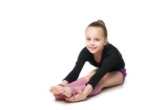 Pretty little girl doing gymnastics over white Stock Image