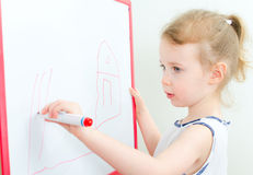 Pretty little girl drawing Royalty Free Stock Photos