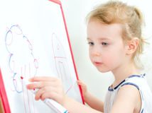 Pretty little girl drawing Royalty Free Stock Photo