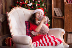 Pretty little girl dreaming with teddy bear near Stock Images