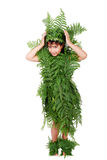 Pretty little girl dressed. In green plant leafs Royalty Free Stock Photography