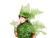 Pretty little girl dressed in green plant leafs Royalty Free Stock Image