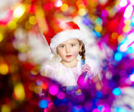 Pretty little girl dressed in santa red hat, new year portrait w Royalty Free Stock Image