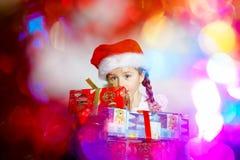 Pretty little girl dressed in santa red hat, new year portrait w Stock Photo