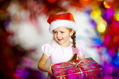Pretty little girl dressed in santa red hat, new year portrait w Royalty Free Stock Photography