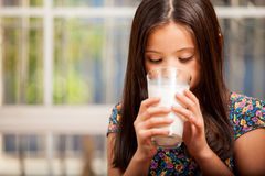 Pretty little girl drinking milk Royalty Free Stock Images