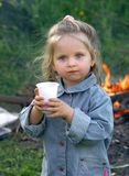 Pretty little girl drinking wate Royalty Free Stock Image