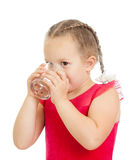 Pretty little girl drinking water from glass Royalty Free Stock Photo