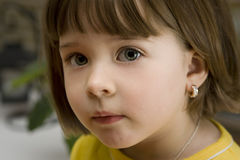 Pretty little girl with an earing Stock Images