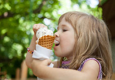 Pretty little girl eating an ice cream Stock Images