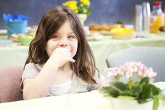 Pretty little girl eating Royalty Free Stock Photo