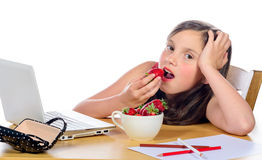 A pretty little girl eats strawberries Stock Image