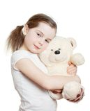 The pretty little girl embraces a teddy bear Stock Photography