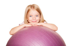 Pretty little girl with fitness ball. Isolated on white Stock Photos