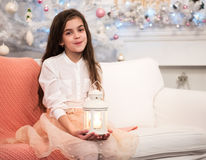Pretty little girl with flashlight Royalty Free Stock Images