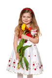 Pretty little girl with flowers. A portrait of a pretty little girl with flowers; isolated on the white background Stock Photo