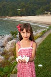 A Pretty Little Girl with Flowers in Her Hands Royalty Free Stock Image