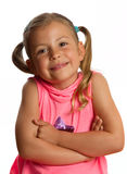 Pretty little girl folding her arms Royalty Free Stock Photos