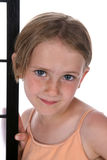 Pretty little girl with freckles. On her nose, standing next to a screen Stock Photography
