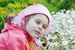 Pretty Little Girl in a Garden Stock Photos