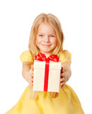 Pretty little girl giving gift. Festive concept. Stock Image