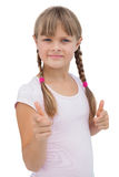 Pretty little girl giving thumbs up Stock Photography