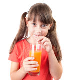 Pretty little girl with a glass of juice Royalty Free Stock Photography