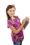 A pretty little girl with glasses writing on a small blackboard Royalty Free Stock Photos