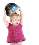 Pretty little girl with globe Earth. Cute little baby with ball of Earth in her hands over white background Royalty Free Stock Images