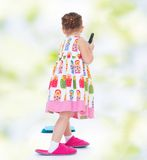 Pretty little girl goes shopping Royalty Free Stock Photos