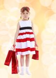 Pretty little girl goes shopping Royalty Free Stock Photo
