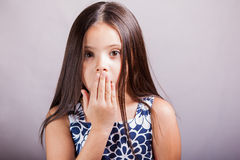 Pretty little girl gossiping Royalty Free Stock Photo